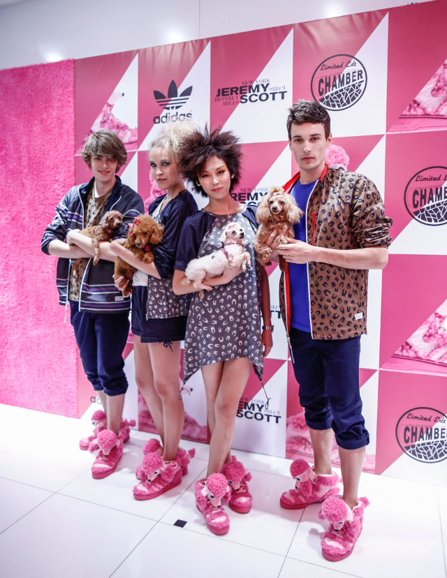 FOR MEN AND WOMEN. Models rock the JS Poodle shoes while carrying the inspiration behind them. These poodles are from Voices of Animals. Photo courtesy of ICON International