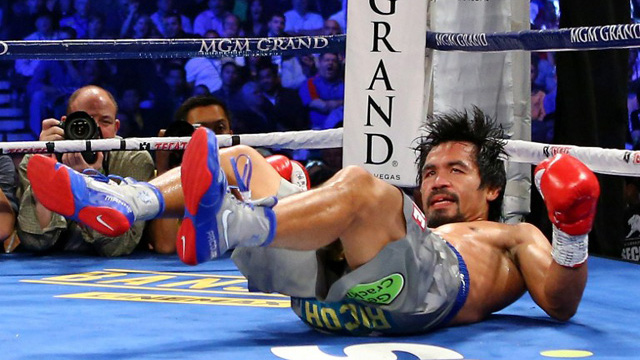 THE WHOLE COUNTRY FELT PACQUIAO's FALL. Pinoys — including celebrities — were quick to express their sentiments on social media. Photo by AFP