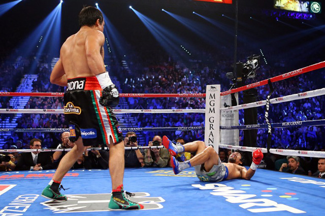 DOWN. Boxing legend Manny Pacquiao is knocked down by Mexico's Juan Miguel Marquez Sunday, December 9. File photo.