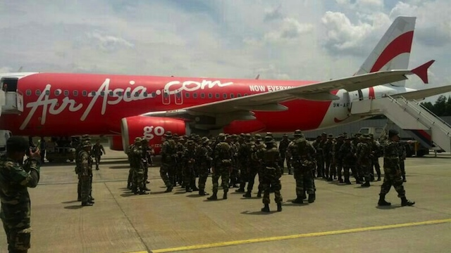 'NOW EVERYONE CAN FLY' Malaysian soldiers wait to board an AirAsia commercial flight to Sabah. Photo from @tonyfernandes