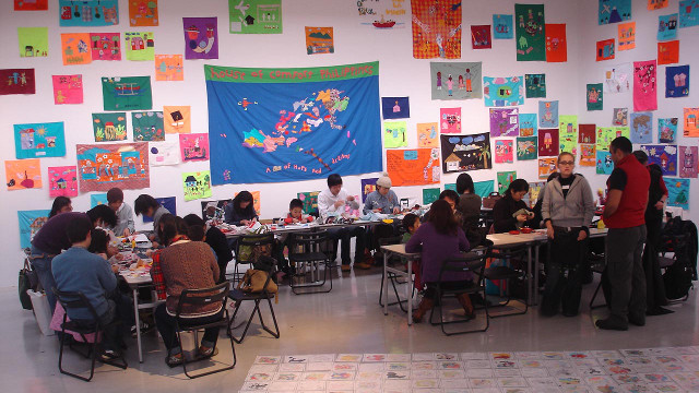 MAKING ART TOGETHER. Participants create works of art at the House of Comfort exhibit and workshop in 2008