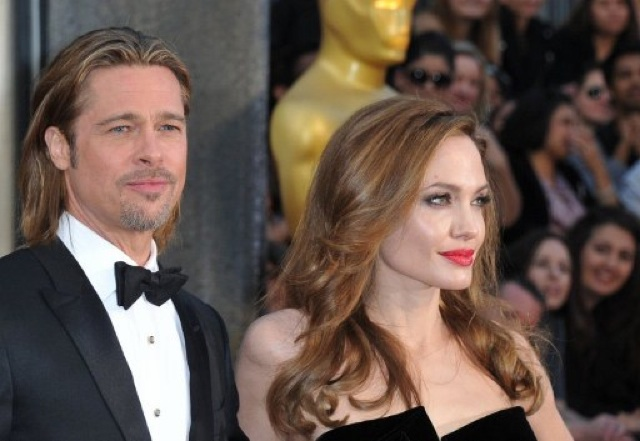ENGAGED. Brad Pitt and Angelina Jolie will tie the knot soon. AFP photo taken during the Academy Awards 2012