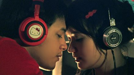 RAMON'S HELLO KITTY HEADPHONES. Movie still courtesy of Trinka Lat