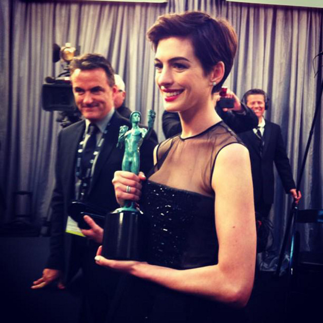 AN OSCAR NEXT? A smiling Anne Hathaway wins Outstanding Female Actor in a Supporting Role in the 19th SAG Awards. Instagram photo from the Screen Actors Guild Awards Facebook page