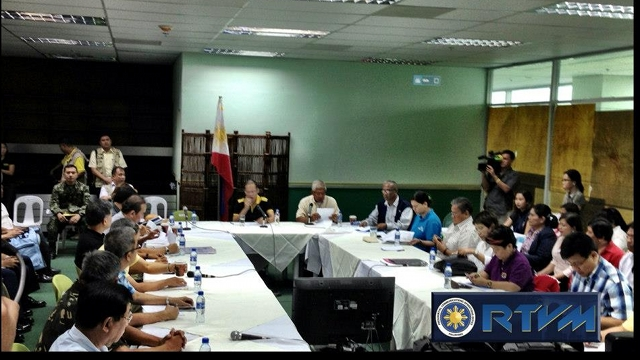 DISASTER BRIEFING. Aquino meets with disaster officials and his Cabinet at the Davao International Airport. to map out the response to Typhoon Pablo. Photo from RTVM