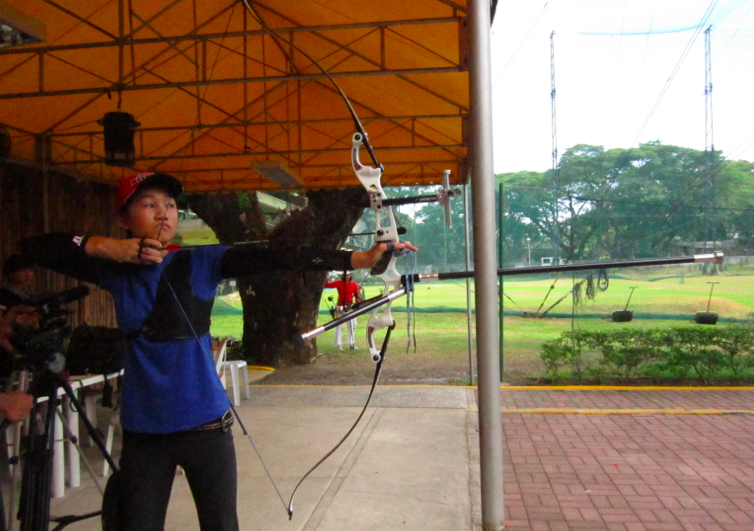EYE ON THE TARGET. Bianca Gotuaco, Archer and Palarong Pambansa athlete shooting a Recurve bow.