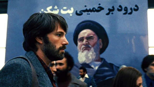 ICONS BOTH. Ben Affleck and a familiar figure in a re-imagined 1979 Tehran. All movie stills from Warner Bros. Pictures