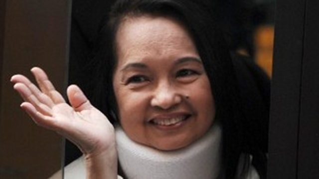 ECONOMY. Former president Gloria Macapagal-Arroyo lauds President Benigno Aquino III for the country's GDP growth. AFP file photo
