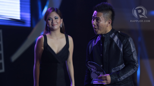 Ney Dimaculangan receives the award