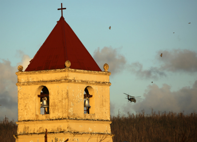 ICONIC BELLS MISSING. A view of a historic Balangiga Church as a US Navy Sea Hawk helicopter flies over in the Haiyan-devastated town of Balangiga, Eastern Samar on Nov 18, 2013. File photo by Francis Malasig/EPA