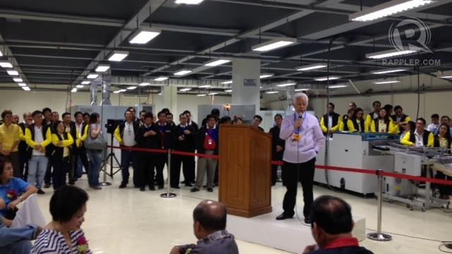NEW FACILITY. Comelec Chair Sixto Brillantes Jr speaks at the ribbon-cutting of the NPO's new venue for ballot-printing. Photo by Paterno Esmaquel II