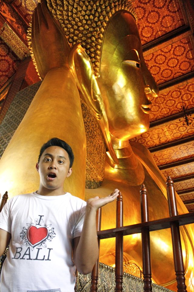 THE RECLINING BUDDHA. This structure stands 15 meters high and is 43 meters long
