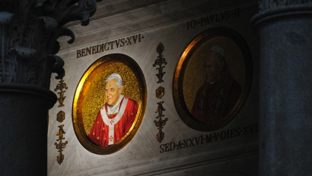 OUTGOING POPE. The portrait of Pope Benedict XVI (L) is displayed next to Pope John Paul II's on a wall of the St Paul Outside the Walls' basilica on February 13, 2013 in Rome. The portraits of each pope are displayed in a frieze extending above the columns separating the four aisles and naves. AFP Photo/Tiziana Fabi