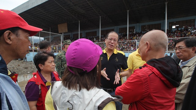 WANTING ANSWERS. President Aquino orders an investigation of local government's disaster response after visiting Compostela Valley and Davao Oriental. Aquino observed that evacuation centers were built in flood-prone areas. Photo by Malacañang Photo Bureau