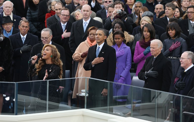 LIP-SYNCHED? Singer Beyonce performs the National Anthem as U.S. President Barack Obama looks on during the public ceremonial inauguration on the West Front of the U.S. Capitol January 21, 2013 in Washington, DC. Alex Wong/Getty Images/AFP