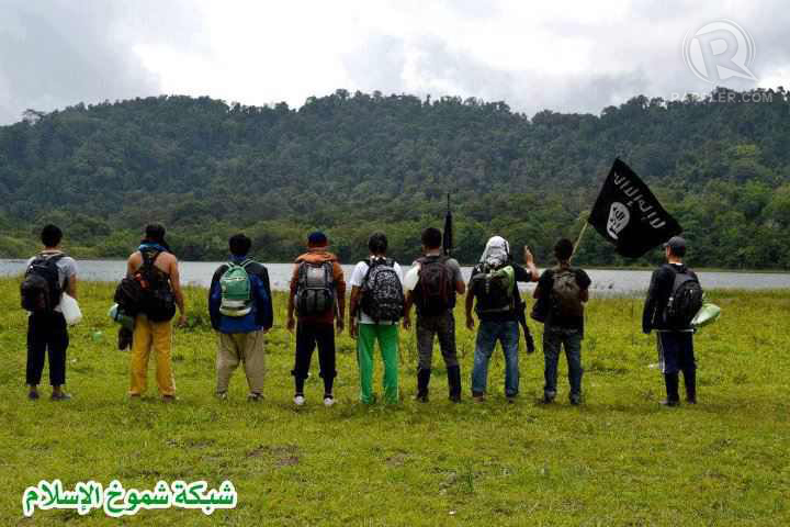 Filipinos carry the black flag in the southern Philippines