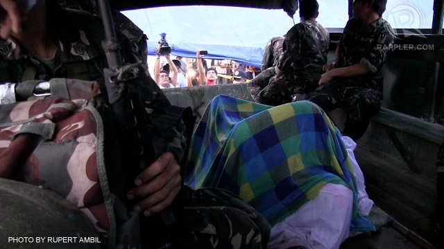 ONLY ONE. Divers recover the body of one of two pilots from the fuselage of the ill-fated plane that crashed off Masbate