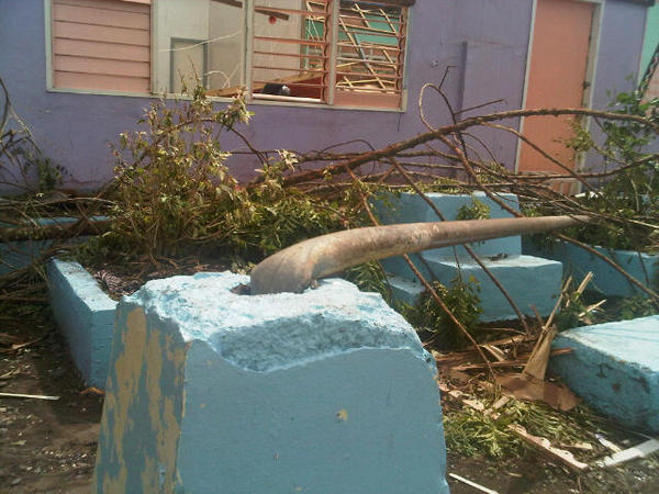 SCHOOL DAMAGED. Secretary Roxas snaps a photo of the damage Pablo brought to an elementary school.