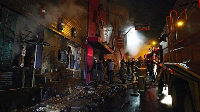 NIGHTCLUB BLAZE.  Firefighters try to put out a fire at a nightclub in Santa Maria, 550 Km from Porto Alegre, southern Brazil on January 27, 2012. The death toll climbed to 150 early Sunday as firefighters searched the charred remains of the establishment, television Globo reported. AFP PHOTO / AGENCIA RBS 