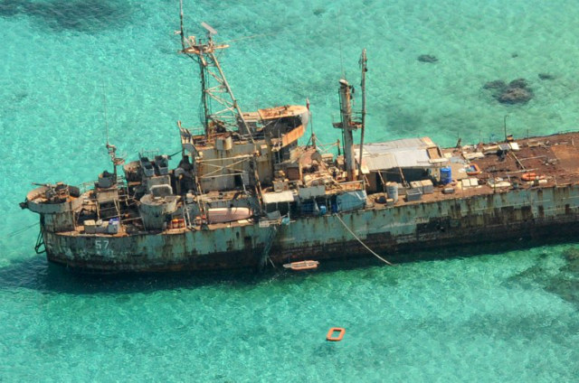 PHILIPPINES' GUARDIAN. An aerial view shows a Philippine Navy vessel that has been grounded since 1999 to assert their nation's sovereignty over Ayungin Shoal, a remote South China Sea reef also claimed by China, on March 29, 2014. Photo by Jay Directo/AFP