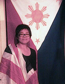 TWO FLAGS. Writer Candy Quimpo Gourlay stands proud with the Philippine and British flags.