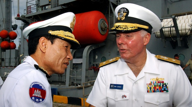 NEW COMMANDING OFFICER. Vice Admiral Tom Carney (R) greets a Cambodian officer durant the CARAT war games in 2011. Photo from US Navy