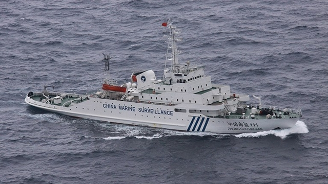 This handout picture taken on December 17, 2012 shows a Chinese marine surveillance ship cruising near the disputed islands known as Senkaku islands in Japan and Diaoyu islands in China, in the East China Sea. Four Chinese government ships entered a band of water around the disputed islands. On December 17, hours after the scale of his win became apparent, Shinzo Abe re-staked Tokyo's claim to sovereignty of islands at the center of a debilitating spat with China. FILE AFP PHOTO / JAPAN COAST GUARD