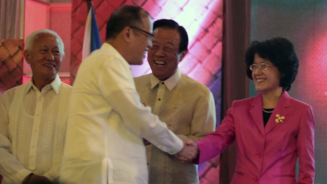 TENSE RELATION President Aquino greets Chinese ambassador Ma Keqing (R) during an official act in Manila. Photo by Gil Nartea / Malacañang Photo Bureau