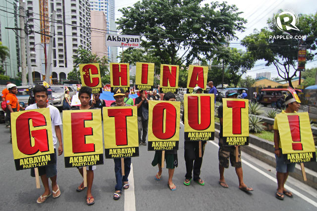 'CHINA GET OUT:' Hundreds of protesters troop to the Chinese consulate in July 2013 to denounce Beijing's 'bullying' over the West Philippine Sea. File photo by Vincent Go