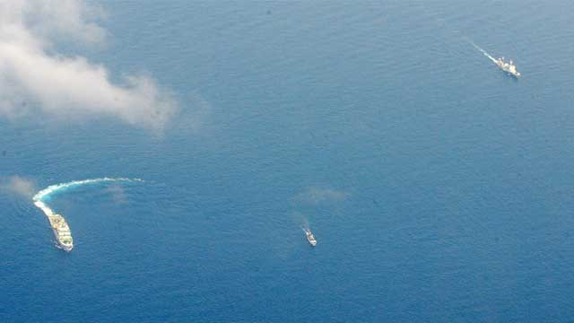 DAVID VS GOLIATH. File photo of a much smaller Philippine ship arrives at the disputed Ayungin Shoal. Photo by AFP