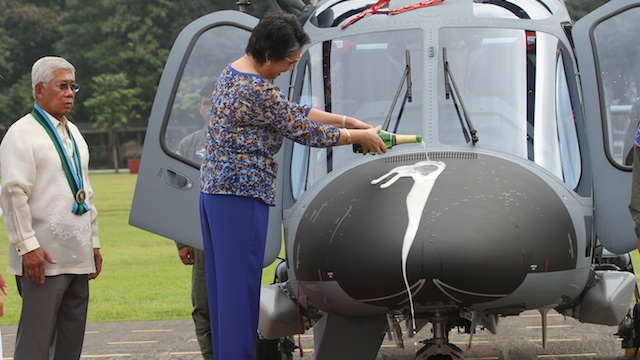 NEW CHOPPERS: The wife of defense secretary Voltaire Gazmin performs the ceremonial pouring of the champagne. Photo from Armed Forces of the Philippines