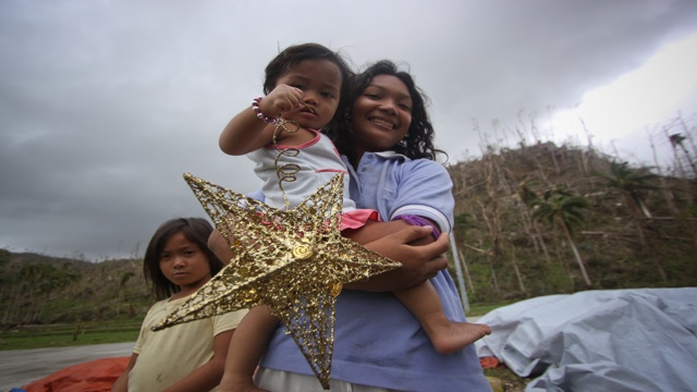 CELEBRATE LIFE. Residents of Davao Oriental are eager to celebrate Christmas with or without food on their tables. Photo by Karlos Manlupig