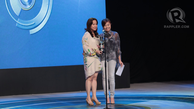 Tara Cabullo (right) presenting the SunShorts Viewer's Choice Award to '1945' by Jun Reyes