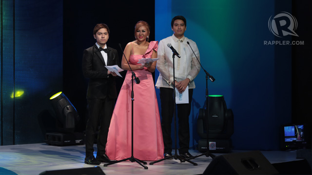 Carlo Aquino and Alfred Vargas (with a lady) presenting the first batch of awards