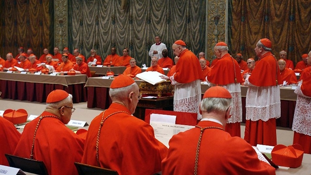 OATH-TAKING. Putting their hands on the Holy Gospels, cardinals vow to keep conclave proceedings secret. File photo from AFP