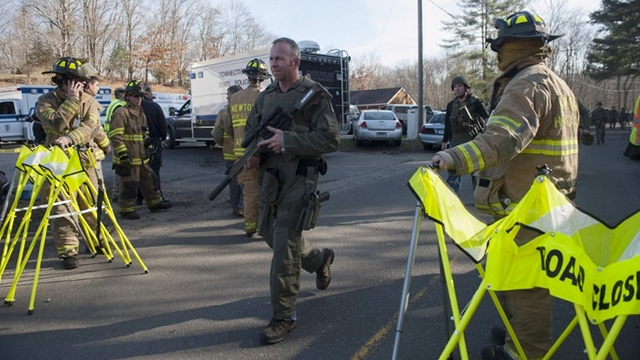 ON ALERT. Connecticut State Police walk near the scene of an elementary school shooting on Friday in Newtown, Connecticut. Photo by Douglas Healey/Getty Images/AFP
