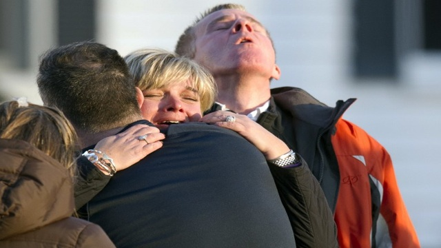 OVERWHELMING GRIEF. Young gunman kills 20 young children and 6 teachers days before Christmas. AFP photo