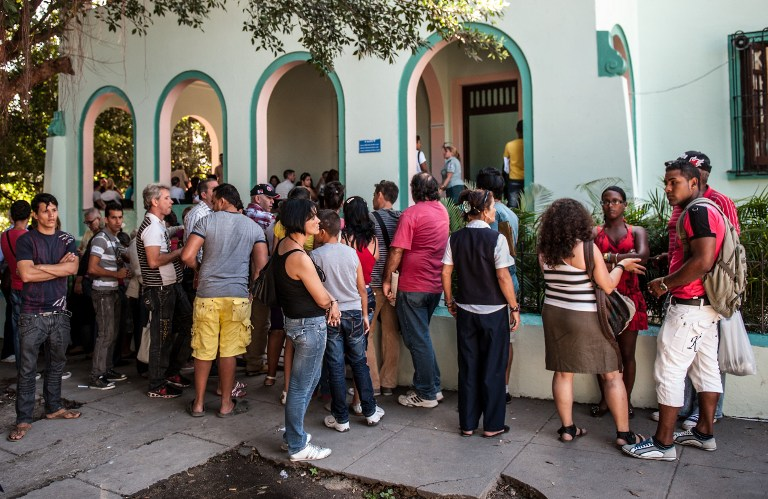 NOW FREE TO TRAVEL. Cubans queue outside a Migration Office to request new passports, on January 14, 2013 in Havana. AFP PHOTO/YAMIL LAGE
