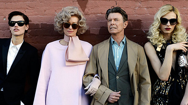 COOL COUPLE. Tilda Swinton (second from left, in pink) and David Bowie (3rd from left) in the music video of 'The Stars (Are Out Tonight).' Photo from the David Bowie Facebook page