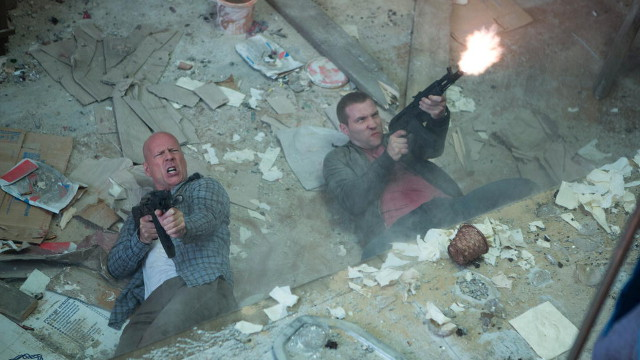 THE FAMILY THAT AIMS TOGETHER. Bruce Willis and Jai Courtney shoot em up in 'A Good Day to Die Hard'