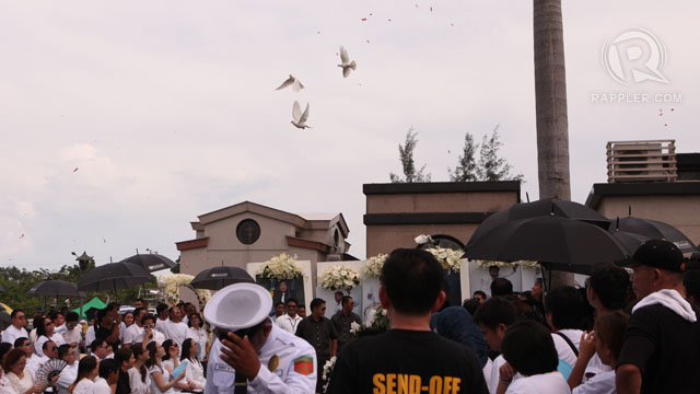 DOVES. They are released at the burial site. Photo by Geric Cruz