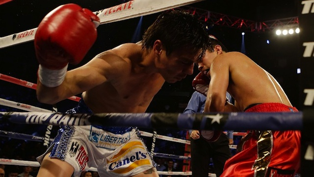LETHAL BLOW. Nonito Donaire of the Philippines (R) knocks out Jorge Arce of Mexico in the third round of their WBO World Super Bantamweight bout at the Toyota Center on December 15, 2012 in Houston, Texas. Scott Halleran/Getty Images/AFP