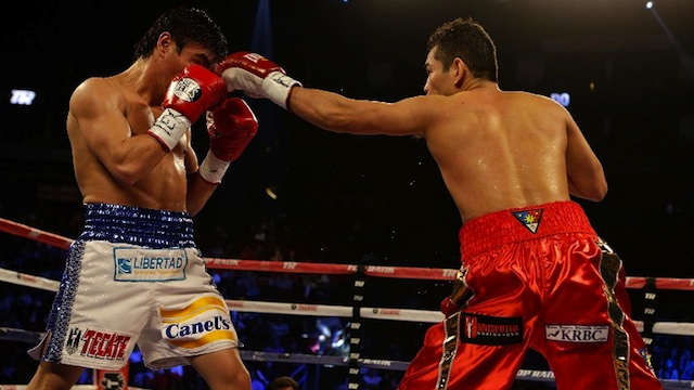 ALWAYS IN CONTROL. Nonito Donaire of the Philippines (R) hits Jorge Arce of Mexico during their WBO World Super Bantamweight bout at the Toyota Center on December 15, 2012 in Houston, Texas. Scott Halleran/Getty Images/AFP