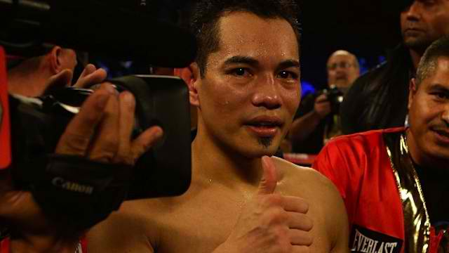 PINOY PRIDE. Nonito Donaire of the Philippines celebrates after his victory over Jorge Arce of Mexico in the third round of their WBO World Super Bantamweight bout at the Toyota Center on December 15, 2012 in Houston, Texas. Scott Halleran/Getty Images/AFP