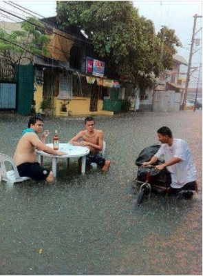 No unstoppable monsoon can stop this men from enjoying a drink. Photo from Facebook