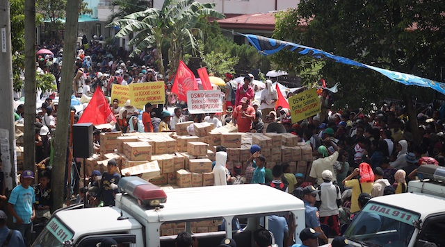 DESPERATION OR LOOTING? The protestors claim they only took relief goods already allotted to them but the DSWD says they were stealing. Photo by Karlos Manlupig