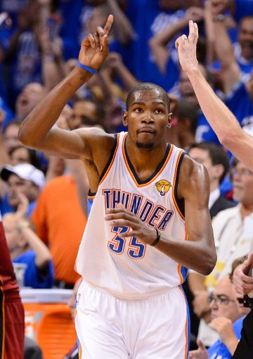 OKLAHOMA CITY, OK - JUNE 12: Kevin Durant #35 of the Oklahoma City Thunder reacts after making a shot in the second half in Game One of the 2012 NBA Finals at Chesapeake Energy Arena on June 12, 2012 in Oklahoma City, Oklahoma. Photo by Ronald Martinez/Getty Images/AFP
