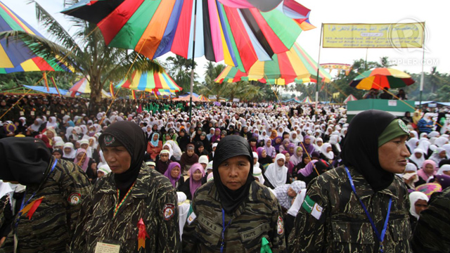 ASPIRING FOR PEACE. Over 500,000 members and supporters of the MILF gather at Camp Darapanan in Maguindanao for the start of the 3-day Bangsamoro Leaders Assembly. Photo taken by Karlos Manlupig