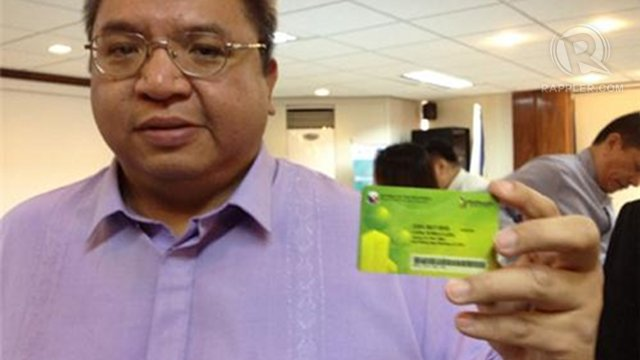 JUST SWIPE IT. Philhealth President Eduardo Banzon shows off the new Philhealth cards which will be released to members beginning August 2012.