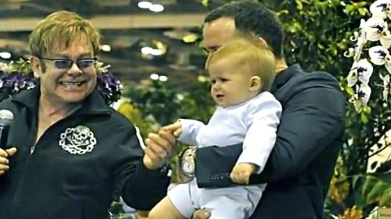 HAPPY DADS, HAPPY BABY. Elton John with David Furnish and Zachary in a video taken at Marina Bay Sands. Screen grab from YouTube (BratPrince84)